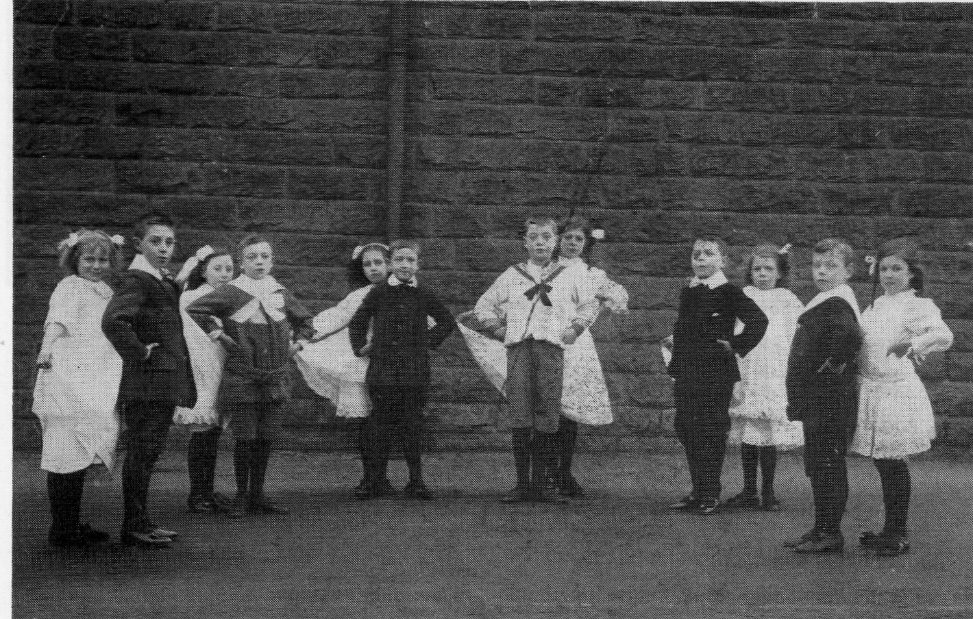 A group of New Park School pupils taking part in a formal dancing lesson c1912